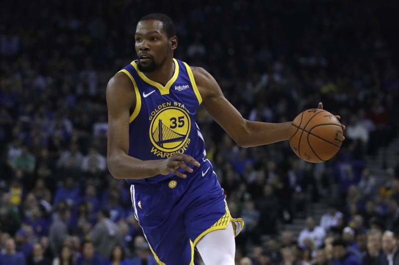 Golden State Warriors' Kevin Durant drives against the Boston Celtics during an NBA basketball game Tuesday, March 5, 2019, in Oakland, Calif. (AP Photo/Ben Margot)