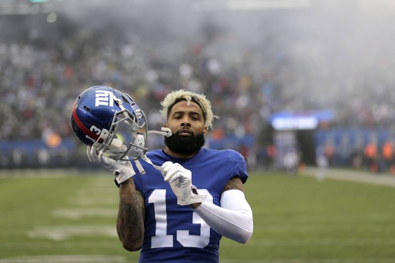 New York Giants wide receiver Odell Beckham adjusts his helmet before putting it on prior to an NFL football game against the Chicago Bears, Sunday, Dec. 2, 2018, in East Rutherford, N.J. (AP Photo/Seth Wenig)