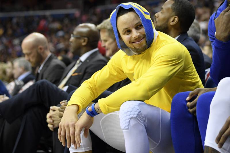 2ff521146d2f Golden State Warriors guard Stephen Curry smiles on the bench during the  first half of the