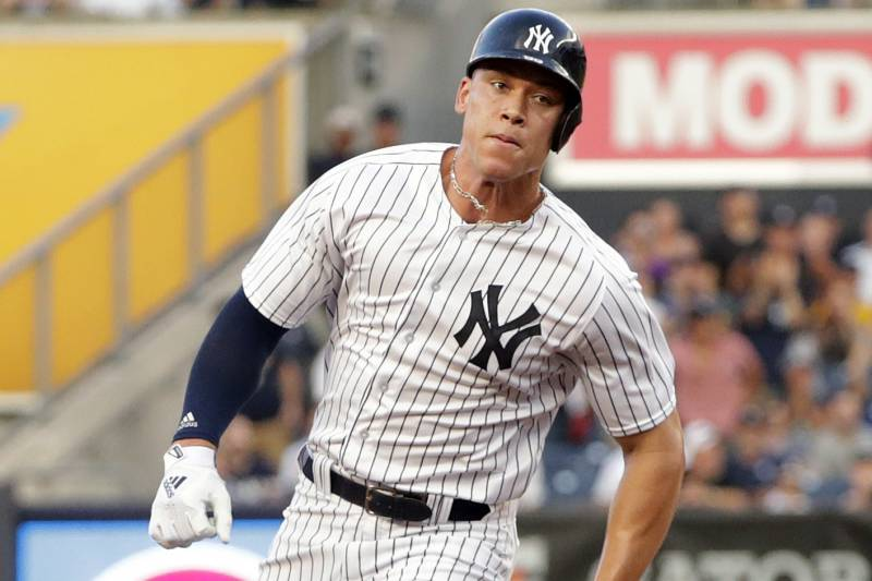 386f8f8b4505b New York Yankees  Aaron Judge runs to third base on a double by Didi  Gregorius