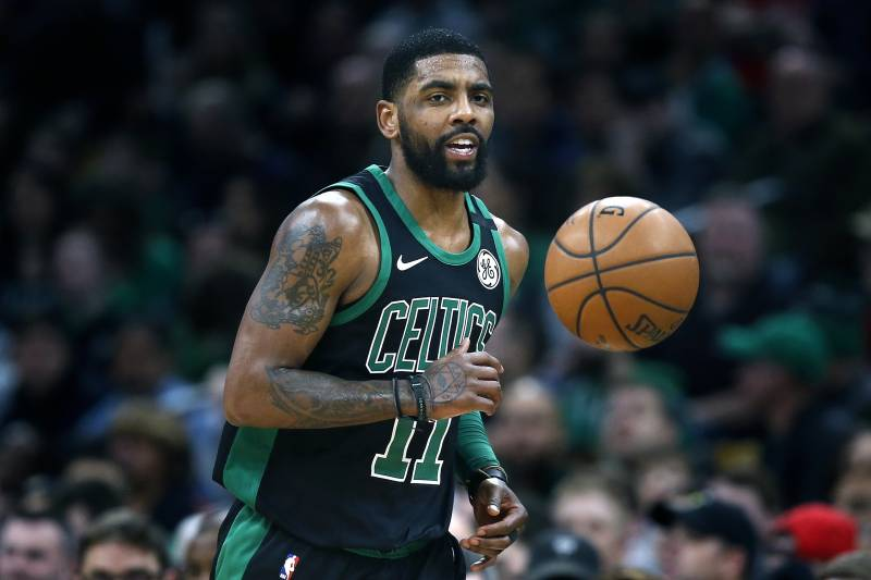 premium selection 62c86 056ff Boston Celtics  Kyrie Irving plays against the Houston Rockets during the  first half of an