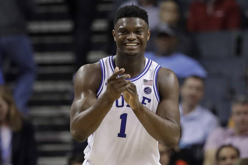 f60daf44337 Duke s Zion Williamson (1) smiles after a play against Syracuse during the  second half