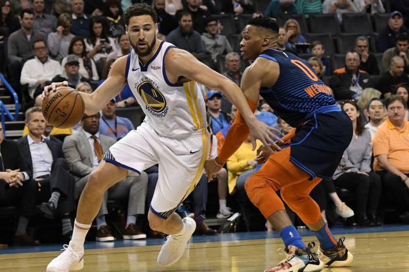 aa84c6fc8215 Oklahoma City Thunder guard Russell Westbrook (0) defends against Golden  State Warriors guard Klay