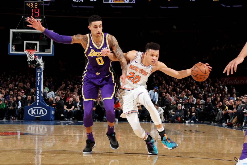 NEW YORK, NY MARCH 17:  Kevin Knox #20 of the New York Knicks handles the ball against Kyle Kuzma #0 of the Los Angeles Lakers during the game on March 17, 2019 at Madison Square Garden in New York City, New York. NOTE TO USER: User expressly acknowledges and agrees that, by downloading and or using this photograph, User is consenting to the terms and conditions of the Getty Images License Agreement.
