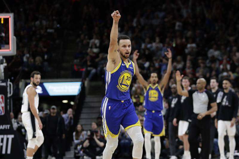 9b19b86def8 Golden State Warriors guard Stephen Curry (30) celebrates after making a  buzzer basket at