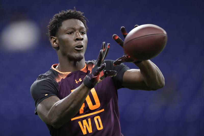 2fb09814941 Georgia wide receiver Riley Ridley runs a drill at the NFL football  scouting combine in Indianapolis