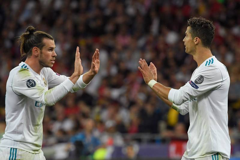 8e62c3dd380 Real Madrid s Welsh forward Gareth Bale (L) celebrates with Real Madrid s  Portuguese forward Cristiano
