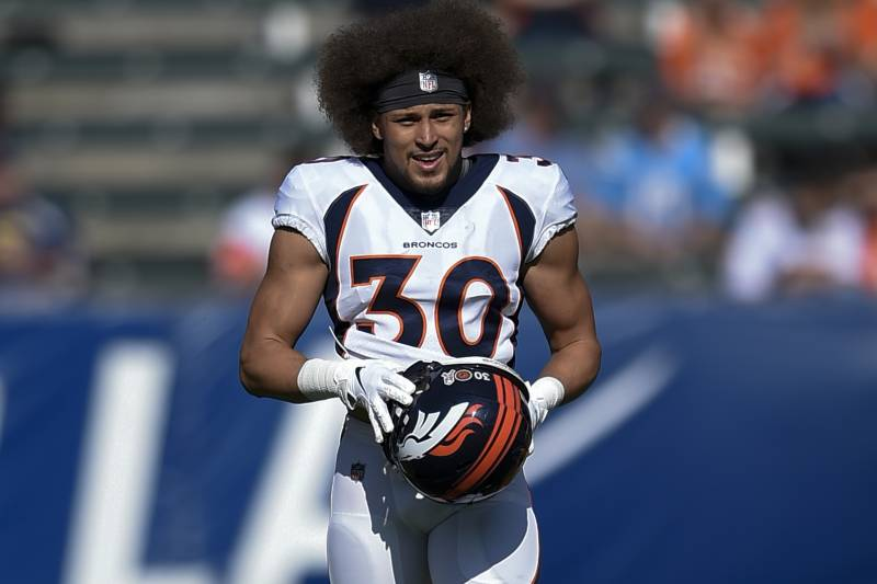 Denver Broncos running back Phillip Lindsay warms up prior to an NFL football game against the Los Angeles Chargers Sunday, Nov. 18, 2018, in Carson, Calif. (AP Photo/Kelvin Kuo)