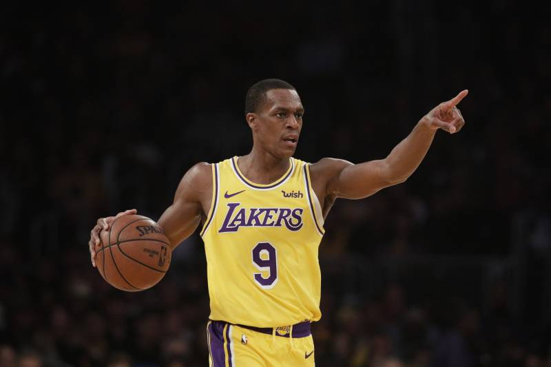 0c6b8f8b3e8 Los Angeles Lakers  Rajon Rondo dribbles the ball during the first half of  an NBA