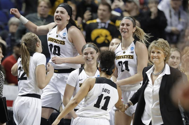 1d24b8675c6e Iowa players including Megan Gustafson (10) and Hannah Stewart (21)  celebrates in
