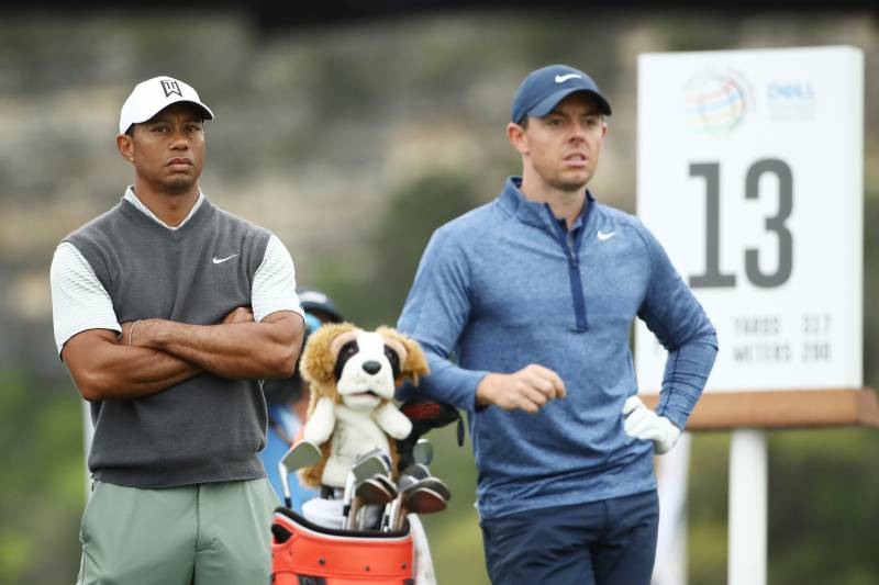 AUSTIN, TEXAS - MARCH 30: Tiger Woods of the United States and Rory McIlroy of Northern Ireland stand on the 13th tee during the fourth round of the World Golf Championships-Dell Technologies Match Play at Austin Country Club on March 30, 2019 in Austin, Texas. (Photo by Ezra Shaw/Getty Images)