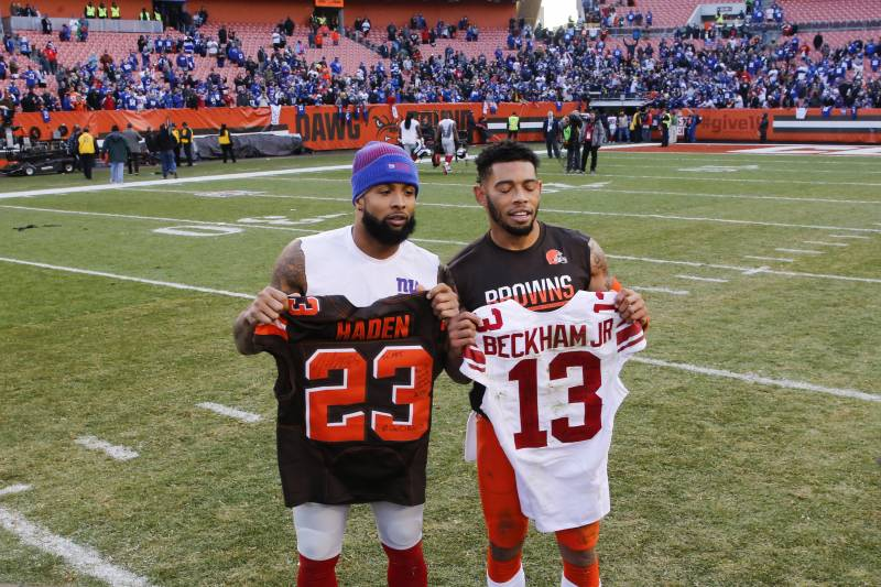 New York Giants wide receiver Odell Beckham, left, and Cleveland Browns cornerback Joe Haden, right, exchange jerseys after an NFL football game, Sunday, Nov. 27, 2016, in Cleveland. (AP Photo/Ron Schwane)