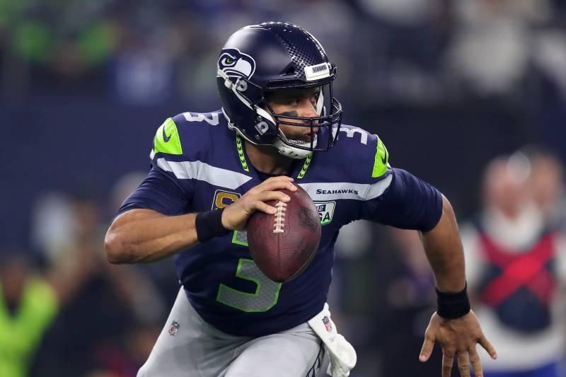 6a332ba2 ARLINGTON, TEXAS - JANUARY 05: Russell Wilson #3 of the Seattle Seahawks  scrambles