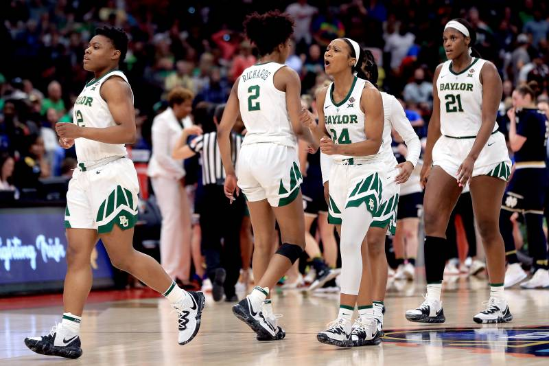 TAMPA, FLORIDA - APRIL 07:  Chloe Jackson #24 of the Baylor Lady Bears celebrates with her teammates after scoring a basket against the Notre Dame Fighting Irish during the fourth quarter in the championship game of the 2019 NCAA Women's Final Four at Amalie Arena on April 07, 2019 in Tampa, Florida. (Photo by Mike Ehrmann/Getty Images)