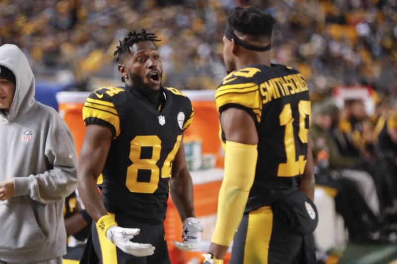 b1cc9b40b Pittsburgh Steelers wide receiver Antonio Brown (84) taks with wide  receiver JuJu Smith-