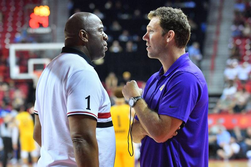 LAS VEGAS, NV - JULY 10:  Head coach Luke Walton of the Los Angeles Lakers talks with Los Angeles Lakers president of basketball operations Earvin 'Magic' Johnson during the 2018 NBA Summer League at the Thomas & Mack Center on July 10, 2018 in Las Vegas, Nevada. The Lakers defeated the Knicks 109-92. NOTE TO USER: User expressly acknowledges and agrees that, by downloading and or using this photograph, User is consenting to the terms and conditions of the Getty Images License Agreement.  (Photo by Sam Wasson/Getty Images)