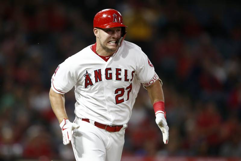 ANAHEIM, CALIFORNIA - APRIL 09:  Mike Trout #27 of the Los Angeles Angels of Anaheim runs to first base after hitting a single during the second inning of a game against the Milwaukee Brewers at Angel Stadium of Anaheim on April 09, 2019 in Anaheim, California. (Photo by Sean M. Haffey/Getty Images)