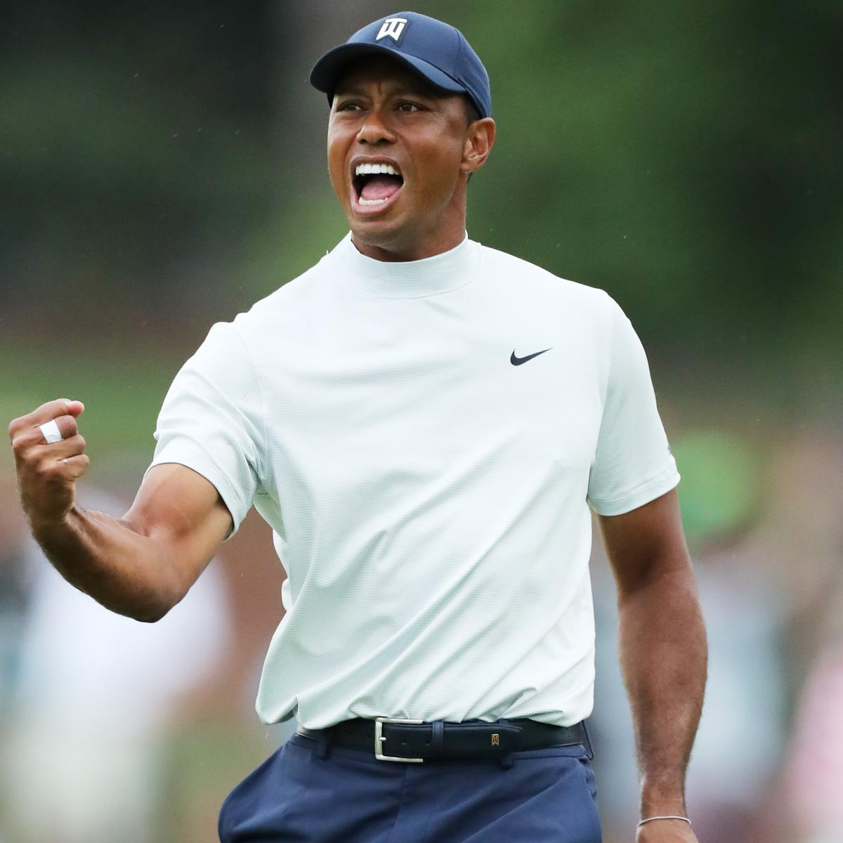 Tiger Woods seemed undeterred after a security guard accidentally slid into him following a shot on the 14th hole at the Masters on Friday at Augusta National Golf Club in Georgia: ...