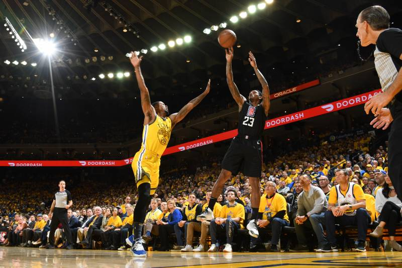 OAKLAND, CA - APRIL 15: Lou Williams #23 of the LA Clippers shoots the ball against the Golden State Warriors during Game Two of Round One of the 2019 NBA Playoffs on April 15, 2019 at ORACLE Arena in Oakland, California. NOTE TO USER: User expressly acknowledges and agrees that, by downloading and or using this photograph, user is consenting to the terms and conditions of Getty Images License Agreement.