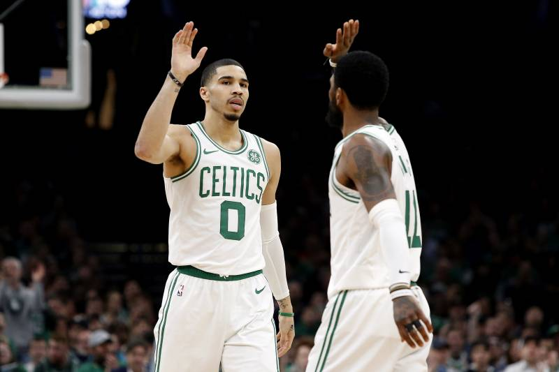 b465606c816c Boston Celtics  Jayson Tatum high fives with Kyrie Irving during the second  quarter of an