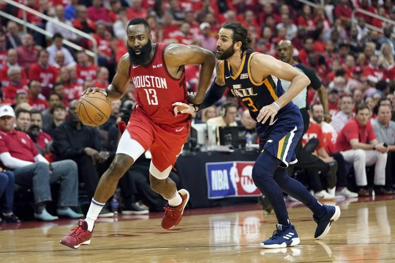 e33f90e0881 Houston Rockets guard James Harden (13) drives against Utah Jazz s Ricky  Rubio (3