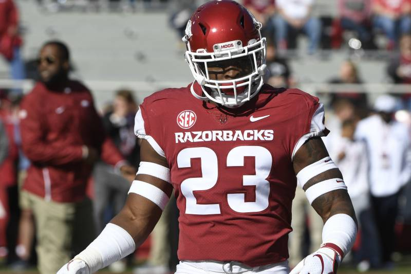 8fb5426febf Arkansas defensive back Dre Greenlaw warms up before playing Tulsa in an  NCAA college football game