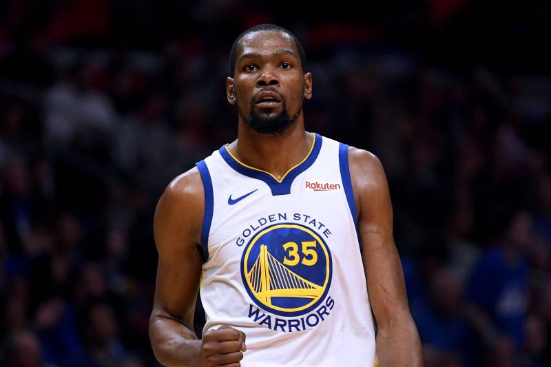 LOS ANGELES, CALIFORNIA - APRIL 18:  Kevin Durant #35 of the Golden State Warriors celebrates a lead at half time over the LA Clippers during Game Two of Round One of the 2019 NBA Playoffs at Staples Center on April 18, 2019 in Los Angeles, California. (Photo by Harry How/Getty Images)  NOTE TO USER: User expressly acknowledges and agrees that, by downloading and or using this photograph, User is consenting to the terms and conditions of the Getty Images License Agreement.