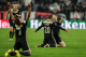 Ajax's Matthijs de Ligt and teammates celebrate at the end of the Champions League, quarterfinal, second leg soccer match between Juventus and Ajax, at the Allianz stadium in Turin, Italy, Tuesday, April 16, 2019. Ajax won 2-1 and advances to the semifinal on a 3-2 aggregate. (AP Photo/Luca Bruno)