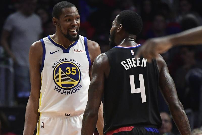 Golden State Warriors forward Kevin Durant, left, and Los Angeles Clippers forward JaMychal Green jaw at each other during the second half in Game 3 of a first-round NBA basketball playoff series Thursday, April 18, 2019, in Los Angeles. The Warriors won 132-105.