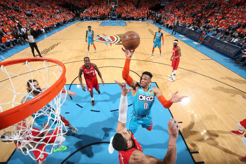 OKLAHOMA CITY, OK - APRIL 19: Russell Westbrook #0 of the Oklahoma City Thunder goes to the basket against the Portland Trail Blazers during Game Three of Round One of the 2019 NBA Playoffs on April 19, 2019 at Chesapeake Energy Arena in Oklahoma City, Oklahoma. NOTE TO USER: User expressly acknowledges and agrees that, by downloading and/or using this photograph, user is consenting to the terms and conditions of the Getty Images License Agreement.