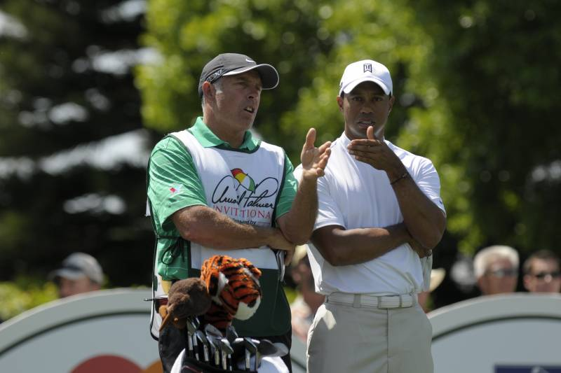Caddie Steve Williams, left, and Tiger Woods discuss his shot during before teeing off on the second hole during the first round of the Arnold Palmer Invitational golf tournament at Bay Hill in Orlando, Fla., Thursday, March 24, 2011.(AP Photo/Phelan M. Ebenhack)