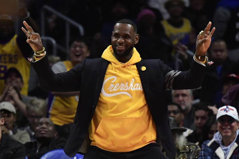 Los Angeles Lakers forward LeBron James celebrates from the bench during the second half of an NBA basketball game against the Los Angeles Clippers Friday, April 5, 2019, in Los Angeles. The Lakers won 122-117.
