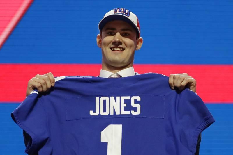online retailer 75501 f1615 Duke quarterback Daniel Jones poses with his new jersey after the New York  Giants selected Jones