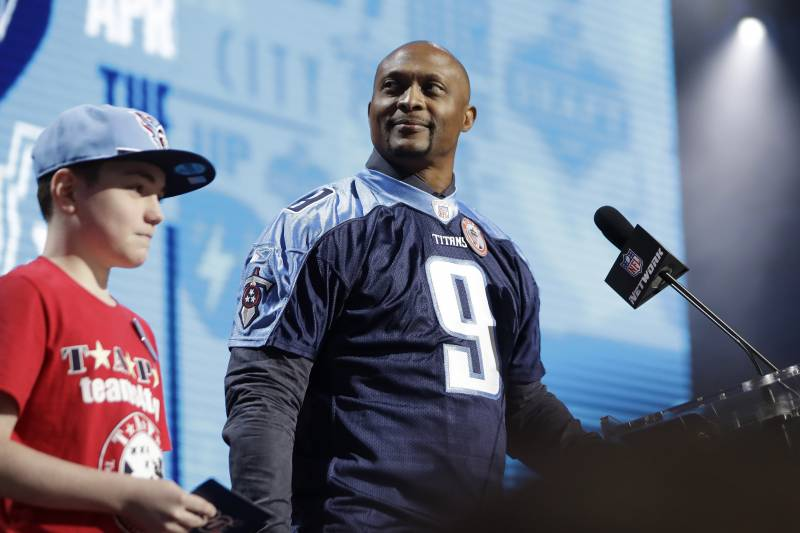Former Tennessee Titans player Eddie George announces the pick for the Titans as Mississippi wide reciever A.J. Brown during the second round of the NFL football draft, Friday, April 26, 2019, in Nashville, Tenn. (AP Photo/Mark Humphrey)