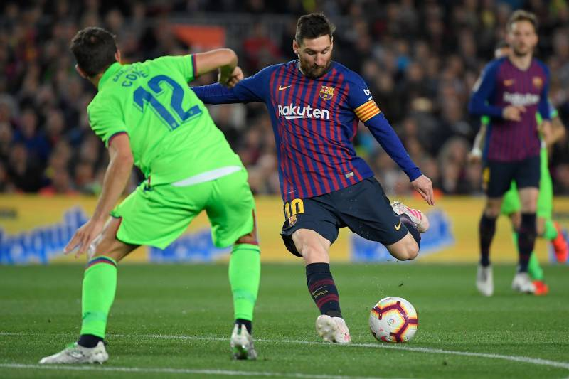 f5cc43d2320 Levante s Spanish defender Coke (L) vies with Barcelona s Argentinian  forward Lionel Messi during the
