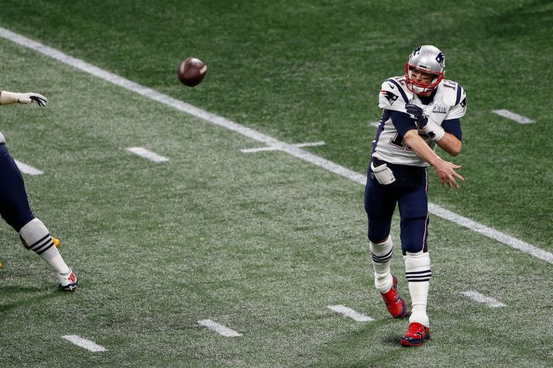 ATLANTA, GEORGIA - FEBRUARY 03: Tom Brady #12 of the New England Patriots passes against the Los Angeles Rams during Super Bowl LIII at Mercedes-Benz Stadium on February 03, 2019 in Atlanta, Georgia. (Photo by Michael Zagaris/Getty Images)