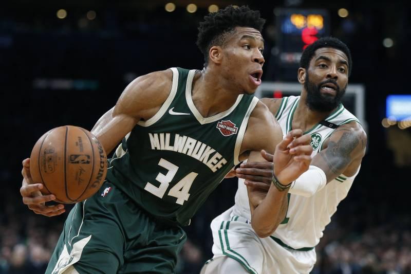 06bc5f20330 Milwaukee Bucks  Giannis Antetokounmpo (34) drives past Boston Celtics   Kyrie Irving during