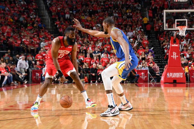 HOUSTON, TX - MAY 4: James Harden #13 of the Houston Rockets handles the ball against Kevin Durant #35 of the Golden State Warriors during Game Three of the Western Conference Semifinals of the 2019 NBA Playoffs on May 4, 2019 at the Toyota Center in Houston, Texas. NOTE TO USER: User expressly acknowledges and agrees that, by downloading and/or using this photograph, user is consenting to the terms and conditions of the Getty Images License Agreement.
