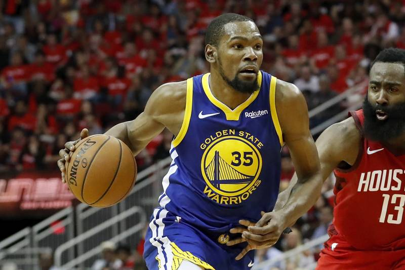 HOUSTON, TX - MAY 04:  Kevin Durant #35 of the Golden State Warriors drives to the basket defended by James Harden #13 of the Houston Rockets in the fourth quarter during Game Three of the Second Round of the 2019 NBA Western Conference Playoffs at Toyota Center on May 4, 2019 in Houston, Texas. NOTE TO USER: User expressly acknowledges and agrees that, by downloading and or using this photograph, User is consenting to the terms and conditions of the Getty Images License Agreement.