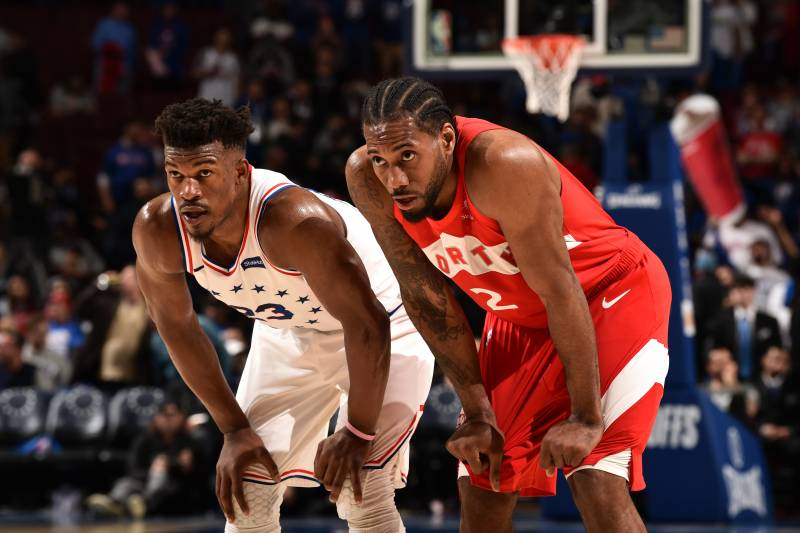 PHILADELPHIA, PA - MAY 5: Jimmy Butler #23 of the Philadelphia 76ers and Kawhi Leonard #2 of the Toronto Raptors looks on during Game Four of the Eastern Conference Semifinals of the 2019 NBA Playoffs on May 5, 2019 at the Wells Fargo Center in Philadelphia, Pennsylvania NOTE TO USER: User expressly acknowledges and agrees that, by downloading and/or using this Photograph, user is consenting to the terms and conditions of the Getty Images License Agreement. Mandatory Copyright Notice: Copyright 2019 NBAE (Photo by David Dow/NBAE via Getty Images)