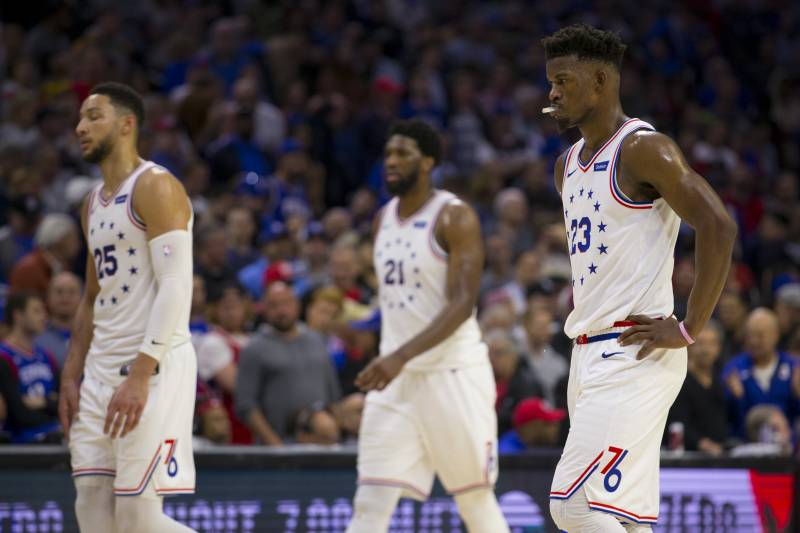 PHILADELPHIA, PA - MAY 05: Ben Simmons #25, Joel Embiid #21, and Jimmy Butler #23 of the Philadelphia 76ers walk to the bench during a timeout against the Toronto Raptors in the fourth quarter of Game Four of the Eastern Conference Semifinals at the Wells Fargo Center on May 5, 2019 in Philadelphia, Pennsylvania. The Raptors defeated the 76ers 101-96.