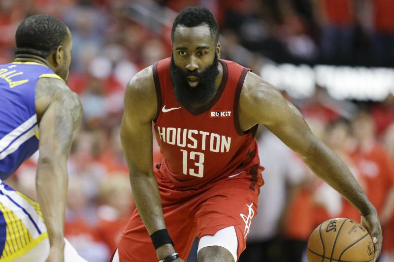 Houston Rockets guard James Harden (13) dribbles as Golden State Warriors guard Andre Iguodala defends during the second half of Game 3 of a second-round NBA basketball playoff series, Saturday, May 4, 2019, in Houston. (AP Photo/Eric Christian Smith)