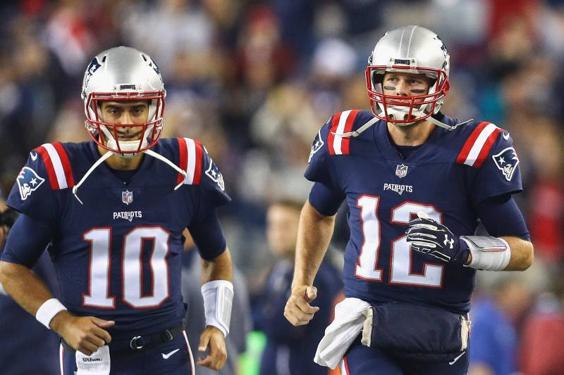 FOXBORO, MA - OCTOBER 22:  Tom Brady #12 and Jimmy Garoppolo #10 of the New England Patriots run onto the field before a game against the Atlanta Falcons at Gillette Stadium on October 22, 2017 in Foxboro, Massachusetts. (Photo by Maddie Meyer/Getty Images)