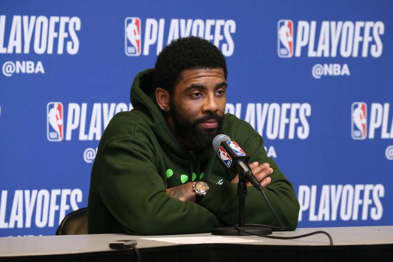MILWAUKEE, WI - MAY 8: Kyrie Irving #11 of the Boston Celtics speaks to the media Game Five of the Eastern Conference Semifinals against the Milwaukee Bucks during the 2019 NBA Playoffs on May 8, 2019 at the Fiserv Forum in Milwaukee, Wisconsin. NOTE TO USER: User expressly acknowledges and agrees that, by downloading and/or using this photograph, user is consenting to the terms and conditions of the Getty Images License Agreement.