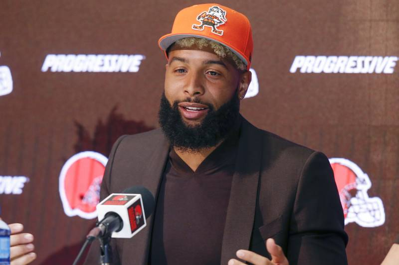 In this April 1, 2019 photo Cleveland Browns' Odell Beckham answers questions during a news conference in Berea, Ohio. Browns coach Freddie Kitchens says he's not upset with star receiver Odell Beckham's absence from the team's voluntary offseason workout program.
