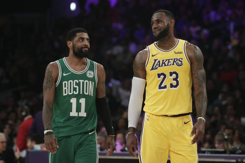 Los Angeles Lakers' LeBron James, right, and Boston Celtics' Kyrie Irving chat during the first half of an NBA basketball game, Saturday, March 9, 2019, in Los Angeles. (AP Photo/Jae C. Hong)