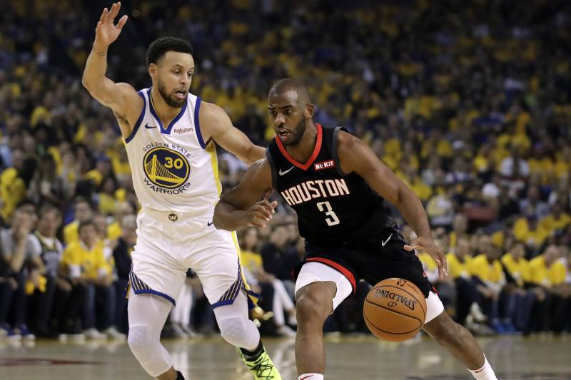 Houston Rockets' Chris Paul, right, drives the ball against Golden State Warriors' Stephen Curry (30) during the first half of Game 5 of a second-round NBA basketball playoff series Wednesday, May 8, 2019, in Oakland, Calif. (AP Photo/Ben Margot)