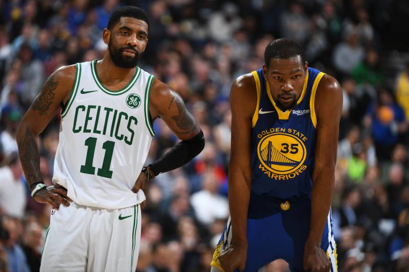 OAKLAND, CA - MARCH 5: Kyrie Irving #11 of the Boston Celtics and Kevin Durant #35 of the Golden State Warriors looks on during the game on March 5, 2019 at ORACLE Arena in Oakland, California. NOTE TO USER: User expressly acknowledges and agrees that, by downloading and or using this photograph, user is consenting to the terms and conditions of Getty Images License Agreement.