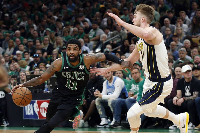 a68b4f65239a Boston Celtics  Kyrie Irving drives on Indiana Pacers  Domantas Sabonisn  during the second quarter