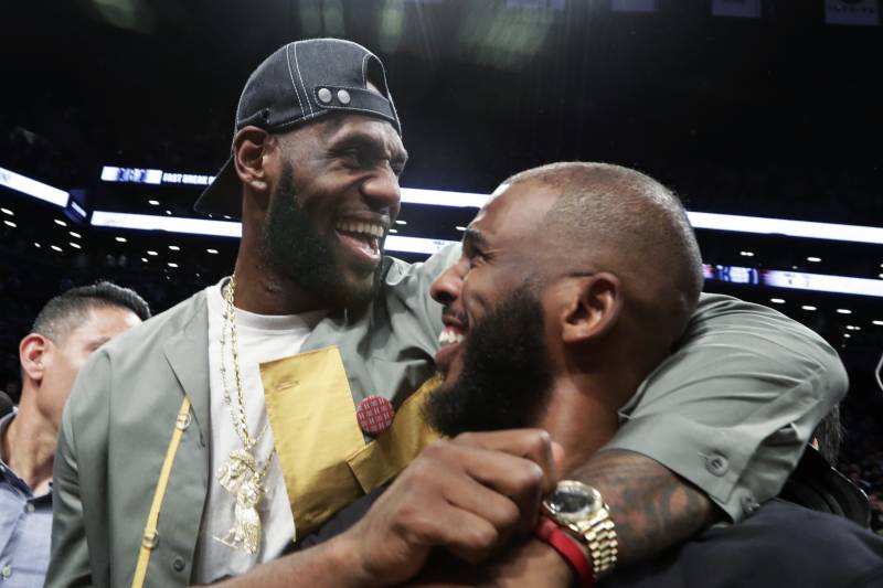 50b07bd8589 LeBron James embraces Chris Paul following an NBA basketball game between  the Brooklyn Nets and the
